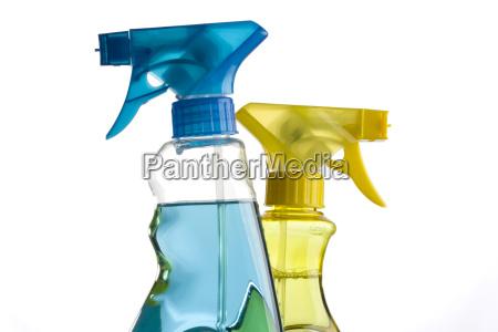 azul y amarillo botellas de spray