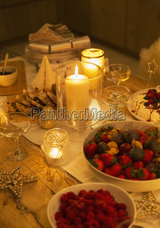 food and decorations on candlelight christmas