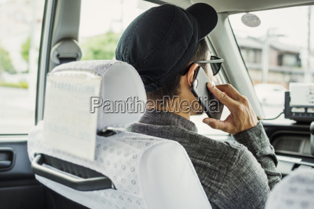 a man seated in the passenger