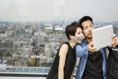two people man and woman taking