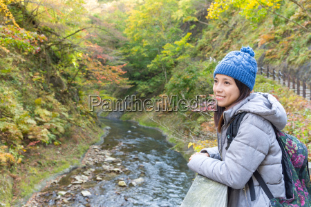 woman go hiking in forest