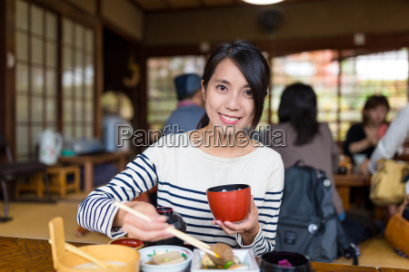 woman enjoy her lunch in japanese