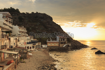 pebbly cove with fishermens houses at
