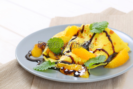 crepes with oranges and chocolate syrup