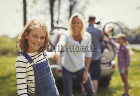portrait smiling mother and daughter holding
